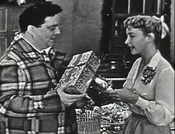 Ralph and Alice Kramden exchanging presents on The Honeymooners